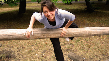 Fiona climbing over a wooden fence